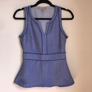 Peplum top with zip closure up the side